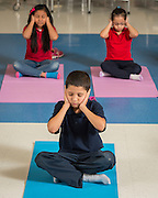 Students participate in a yoga class at Sherman Elementary School, November 19, 2015.