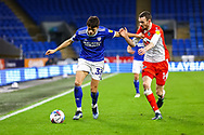 Cardiff City's Perry Ng (38) under pressure from Millwall's Scott Malone (14) during the EFL Sky Bet Championship match between Cardiff City and Millwall at the Cardiff City Stadium, Cardiff, Wales on 30 January 2021.