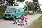 Young polish bicycler waiting for truck to pass boy age 8. Zawady Central Poland