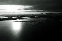 Flyfoto av Giske, Valderøya og Sunnmørsalpene.<br /> Foto: Svein Ove Ekornesvåg