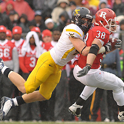 Dec 5, 2009; Piscataway, NJ, USA; Rutgers running back Joe Martinek (38) is tackled during first half NCAA Big East college football action between Rutgers and West Virginia at Rutgers Stadium.