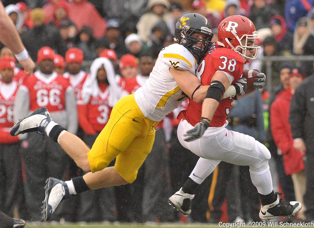 Dec 5, 2009; Piscataway, NJ, USA; Rutgers running back Joe Martinek (38) is tackled during first half NCAA Big East college football action between Rutgers and West Virginia at Rutgers Stadium.