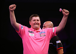Keegan Brown celebrates winning his match with Karel Sedlacek during day three of the William Hill World Darts Championships at Alexandra Palace, London.