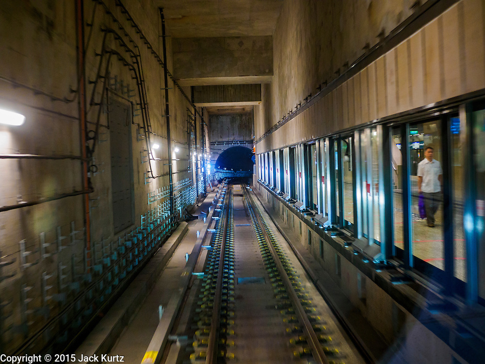 """27 DECEMBER 2015 - SINGAPORE, SINGAPORE:  A train goes through the subway tunnels on the newly expanded Downtown Line in Singapore. Singapore opened the extension of the Downtown Line on its subway system Sunday. The extension is a part of Singapore's plans to make the city-state a """"car lite"""" metropolis with plans to double the current subway to more than 360 kilometers of track by 2030. The government plans to have 80% of homes within a 10 minute walk of a subway station.   PHOTO BY JACK KURTZ"""