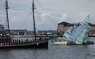 """A fjord tour ship is a stark contrast as it passes by """"She Lies,"""" a steel and glass sculpture by Monica Bonvicini, near the Operahuset in Oslo, Norway, on May 10, 2013. (© 2013 Cindi Christie)"""