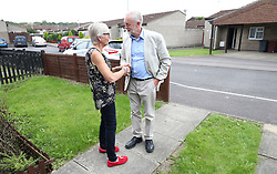 Labour leader Jeremy Corbyn greets Carol Woolford at her home in Reading West, before speaking to her about fuel poverty.