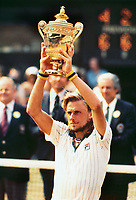 Tennis - 1976 Wimbledon Championships - Men's Singles Final<br /> <br /> Bjorn Borg lifts the trophy on Centre Court after defeating Ilie Nastase.<br /> <br /> It was Borg's first Wimbledon title.