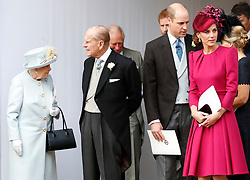 Queen Elizabeth II, the Duke of Edinburgh, and the Duke and Duchess of Cambridge leave after the wedding of Princess Eugenie of York and Jack Brooksbank in St George's Chapel, Windsor Castle.