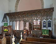 Elaborately decorated wooden rood screen in church of Saint Andrew, Bramfield, Suffolk, England, UK