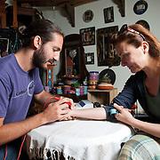 Acupuncturist  Evripides Siouras 28, at work.