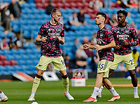 Football - 2021 / 2022 Premier League - Burnley vs. Arsenal<br /> <br /> Rob Holding, Gabriel Martinelli and Albert Sambi Lokonga of Arsenal l warm up before the game today, at Turf Moor.<br /> <br /> <br /> COLORSPORT/ALAN MARTIN