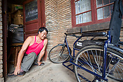 Wang suffers from disabilities caused by polio but is able to run a successful repair shop and retains mobility courtesy of a three-wheeled chair provided by the local Disabled persons' Federation.