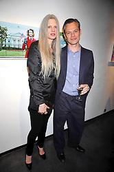 MILES ALDRIDGE and his wife KIRSTEN McMENAMY at an exhibition of photographs by Miles Aldridge held at Hamiltons, Carlos Place, London on 31st March 2009.