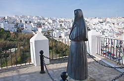 View of whitewashed village with sculpture of moorish women in foreground