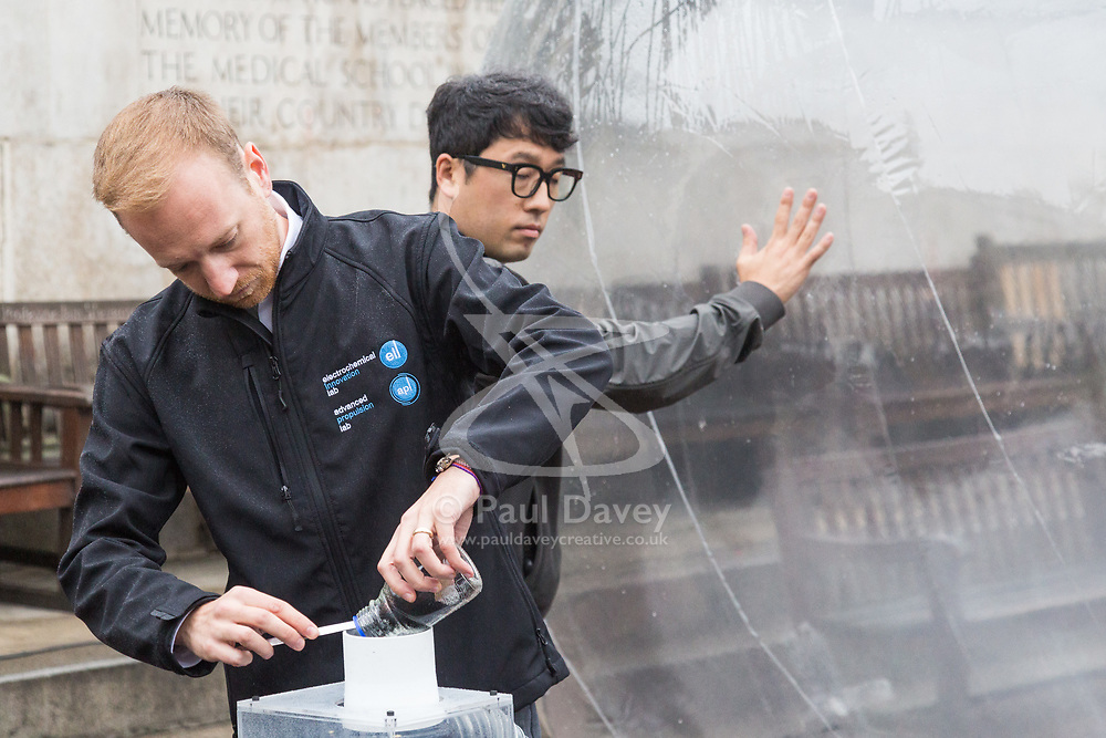 Dr Michael Whitely, Head of Fuel Cell Engineering at UCL feeds pollution particulates into a balloon containing dirty air as Hyundai UK demonstrates the Hydrogen-powered Nexo that not only produces completely clean emissions but also cleans up the air its engine ingests, thanks to a filtration system developed by scientists at University College London. UCL London, October 17 2018.