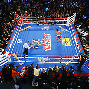 MACAU - NOVEMBER 23:  Manny Pacquiao of the Philippines knocks down Chris Algieri of the United States during the world welterweight title at The Venetian on November 23, 2014 in Macau, Macau.  (Photo by Chris Hyde/Getty Images) *** Local Caption *** Manny Pacquiao; Chris Algieri