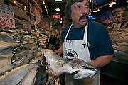 Fishmongers sell seafood at the Pike Place Market in downtown Seattle, Washington, United States.