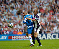 Photo: Leigh Quinnell.<br /> West Brom v Birmingham City. The Barclays Premiership. Birminghams Muzzy Izzet tangles with West Broms Ronnie Wallwork.<br /> 27/08/2005.