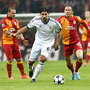 Galatasaray's Umut Bulut (R) and Real Madrid's Sami Khedira (C) during their UEFA Champions League Quarter-finals, Second leg match Galatasaray between Real Madrid at the TT Arena AliSamiYen Spor Kompleksi in Istanbul, Turkey on Tuesday 09 April 2013. Photo by Aykut AKICI/TURKPIX