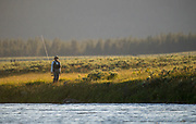 Visiting Japenese angler stalks the banks of the Rainroad Ranch section of the Henry's Fork.