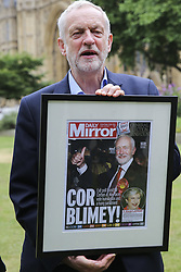 June 27, 2017 - London, UK. Jeremy Corbyn with a framed copy of front page of Daily Mirror attends a Pride of Britain photocall in Westminster.  The Pride of Britain Awards honour British people who have acted bravely or extraordinarily in challenging situations. (Credit Image: © Dinendra Haria/London News Pictures via ZUMA Wire)