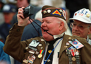 D-Day veteran, William A. Headley, photographs the commemorative ceremonies at Omaha Beach for the 50th Anniversary of the allied landing during World War II.