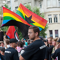 Security personnel line up to protect participants of the Gay Pride March from planned attacks of far-right anti-protesters in Budapest, Hungary on June 18, 2011. ATTILA VOLGYI