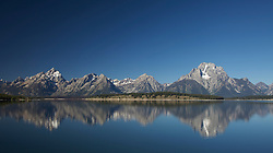 """Grand Teton Reflections in the water of Jackson Lake in Grand Teton National Park.<br /> <br /> For production prints or stock photos click the Purchase Print/License Photo Button in upper Right; for Fine Art """"Custom Prints"""" contact Daryl - 208-709-3250 or dh@greater-yellowstone.com"""