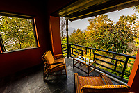 Covered porch of a bungalow at Tiger Mountain Pokhara Lodge, above Pokhara, Nepal.