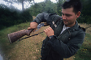 HUNTING WILD BOAR, France. Ardeche.  hunters  with guns and ammunition. Wild boar & deer hunting with hounds. A pursuit which is loved by some and hated by others. The hunters say hunting is natural, their opposers say it is bloodthirsty. There are millions of guns and it is a popular bloodsport.