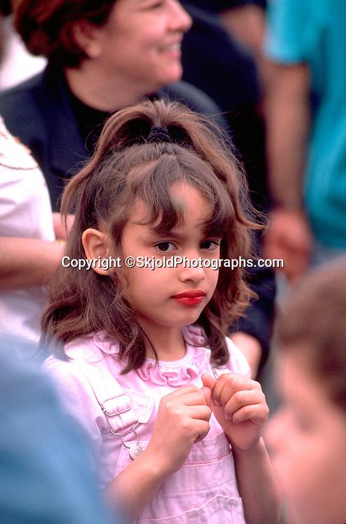 Pensive girl age 6 at Cinco de Mayo Festival.  St Paul  Minnesota USA