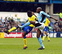 Photo. Chris Ratcliffe<br /> Fulham v Arsenal. FA Premiership. 09/05/2004<br /> kolo Toure and Luis boa Morte tussle for the ball
