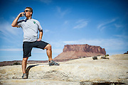 SHOT 10/16/16 12:40:14 PM - Tom Reynolds of Denver, Co. drinks a beer while taking in the view at White Crack during a White Rim mountain biking trip in Canyonlands National Park just outside of Moab, Utah. The White Rim Road is a 71.2-mile-long unpaved four-wheel drive road that traverses the top of the White Rim Sandstone formation below the Island in the Sky mesa of Canyonlands National Park in southern Utah in the United States. The road was constructed in the 1950s by the Atomic Energy Commission to provide access for individual prospectors intent on mining uranium deposits for use in nuclear weapons production during the Cold War. Four-wheel drive vehicles and mountain bikes are the most common modes of transport though horseback riding and hiking are also permitted.<br /> (Photo by Marc Piscotty / © 2016)