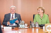 20 AUG 2008, BERLIN/GERMANY:<br /> Frank-Walter Steinmeier (L), SPD, Bundesaussenminister, und Angela Merkel (R), CDU, Bundeskanzlerin, vor Beginn einer Kabinettsitzung, Kabinettsaal, Bundeskanzleramt<br /> IMAGE: 20080820-01-037<br /> KEYWORDS: Kabinett, Sitzung