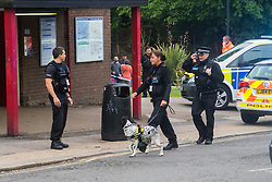 "Kensal Green, London, May 31st 2016. Police in body armoured protective headgear seal off Kensal Green tube station in North West London in what is described as a ""security incident"". PICTURED: A sniffer dog searches the perimeter of the station."