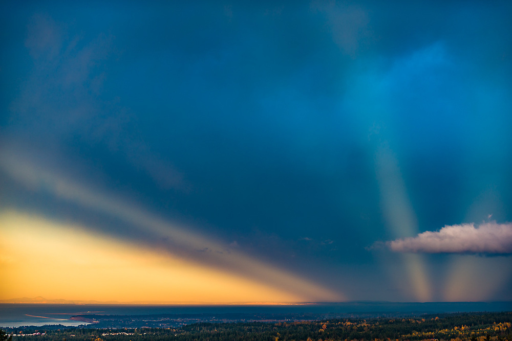 Evening light rays over the Salish Sea and Whidbey Island, October, view from the North Olympic Peninsula, WA, USA