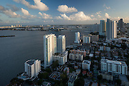 Aerial view of Miami at sunset looking south featuring the Edgwater neighborhood north of downtown Miami on Biscayne Bay.