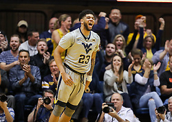 Feb 26, 2018; Morgantown, WV, USA; West Virginia Mountaineers forward Esa Ahmad (23) celebrates after a dunk during the first half against the Texas Tech Red Raiders at WVU Coliseum. Mandatory Credit: Ben Queen-USA TODAY Sports