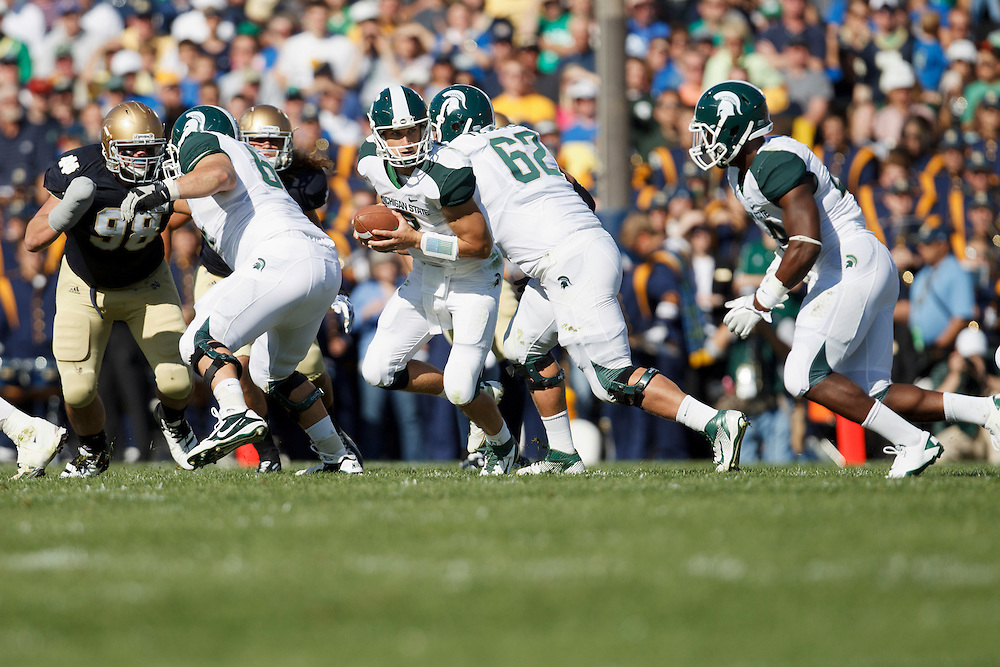 Michigan State quarterback Kirk Cousins (#8) looks to hand the ball off to Michigan State running back Le'Veon Bell (#24) in action during NCAA football game between Notre Dame and Michigan State.  The Notre Dame Fighting Irish defeated the Michigan State Spartans 31-13 in game at Notre Dame Stadium in South Bend, Indiana.