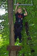 Town of Wallkill, New York - Children from Ninja Warrior Day Camp climb on ropes courses at Ring Homestead Camp on July 8, 2014.
