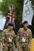 Soldiers of the Royal Artillery regiment in the British army stand guarding the entrance to  the volleyball venue in central London next to the IOC rings logo on day 4 of the London 2012 Olympic Games. A total of 18,000 defence personel were called upon to make the Games secure following the failure by security contractor G4S to provide enough private guards. The extra personnel have been drafted in amid continuing fears that the private security contractor's handling of the £284m contract remains a risk to the Games.