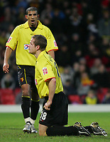 Fotball<br /> FA Cup England 2004/2005<br /> 3. runde<br /> 08.01.2005<br /> Foto: SBI/Digitalsport<br /> NORWAY ONLY<br /> <br /> Watford v Fulham<br /> <br /> Watford's Heidar Helguson is shows his disapointment at missing a goal with  team mate Hameur Bouazza