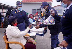 South Africa - Cape Town - 29 July 2020 - Nozizwe Nomnqa getting foor from harare SAPS. Harare SAPS hosted a Mandela day event in their own backyard. They invited 50 victims of crime and conducted crime awareness on issues pertaining to the attacks on woman and children. They were sensitized to always be vigilant and report any crimes committed on them or in their presence. Police handed out toiletry packs to each one and further dished a cooked meal for them. photographer Ayanda Ndamane African News Agency (ANA)