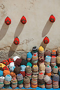 Stacked hats for sale from a shop in the medina of Essaouira, Morocco