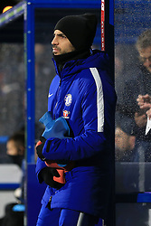 12th December 2017 - Premier League - Huddersfield Town v Chelsea - Cesc Fabregas of Chelsea holds a hot water bottle on the sidelines during the match - Photo: Simon Stacpoole / Offside.