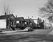 Y-510222-04. NW 19th between Savier & Thurman, west side of block. Terminal Tavern on right at corner. February 22, 1951.