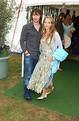 Singer JAMES BLUNT and CAMILLA BOLER at the 2005 Cartier International Polo between England & Australia held at Guards Polo Club, Smith's Lawn, Windsor Great Park, Berkshire on 24th July 2005.<br /><br />NON EXCLUSIVE - WORLD RIGHTS