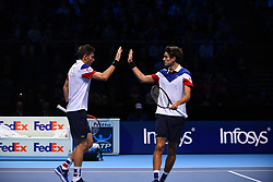 November 14, 2017 - London, England, United Kingdom - France's Pierre-Hugues Herbert and France's Nicolas Mahut (L) play against USA's Ryan Harrison and New Zealand's Michael Venus during their men's doubles round-robin match on day three of the ATP World Tour Finals tennis tournament at the O2 Arena in London on November 14, 2017. (Credit Image: © Alberto Pezzali/NurPhoto via ZUMA Press)