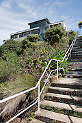Contemporary architecture and mosaic steps seen from the path on the Coogee to Bondi beach Coastal walk