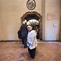 MILAN, ITALY - DECEMBER 07:  One of the eldest canons walks past the exit of the crypt containing the relics of Saint Ambrogio on December 7, 2010 in Milan, Italy. The skeleton of Saint Ambrogio lays with the remains of San Gervasio e San Protasio in the ancient basilica of Sant'Ambrogio in the city centre of Milan